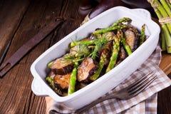 Eggplant casserole with green asparagus. A Eggplant casserole with green asparagus Stock Images