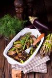 Eggplant casserole with green asparagus. A Eggplant casserole with green asparagus Royalty Free Stock Photos