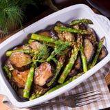 Eggplant casserole with green asparagus. A Eggplant casserole with green asparagus Stock Image