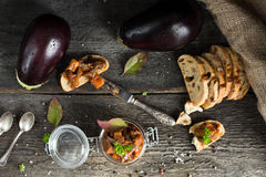Eggplant caviar in glass jar with ciabatta, punch and basil. Eggplant Dip royalty free stock photo