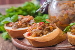 Eggplant caviar in a glass jar with croutons Royalty Free Stock Photo