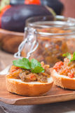 Eggplant caviar in a glass jar with croutons Stock Image