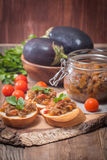 Eggplant caviar in a glass jar with croutons Royalty Free Stock Image