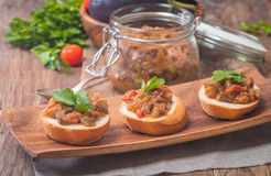 Eggplant caviar in a glass jar with croutons Royalty Free Stock Photography