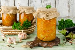 Eggplant caviar in a glass jar on a wooden table Royalty Free Stock Image