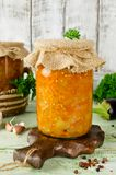 Eggplant caviar in a glass jar on a wooden table Royalty Free Stock Images
