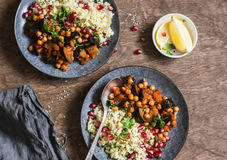 Eggplant and chickpea stew and bulgur on a wooden table, top view. stock photo
