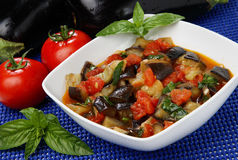 Eggplant cubes. Cauliflower and tomato stew in bowl Royalty Free Stock Photos