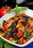 Eggplant cubes. Cauliflower and tomato stew in bowl Stock Photo