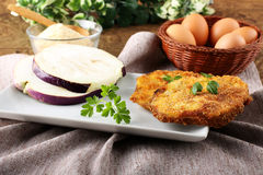 Eggplant cutlet  with beaten egg and breadcrumbs Royalty Free Stock Images