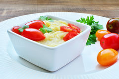 Eggplant dip in white bowl with tomatoes Stock Photo