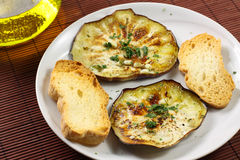 Eggplant with garlic and parsley Royalty Free Stock Photo