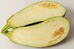 Eggplant half isolated Stock Photos