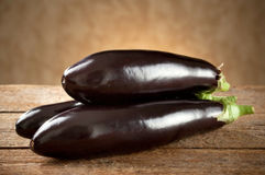 Eggplant on old wooden table Royalty Free Stock Photos