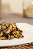 Eggplant with olive oil and parsley Stock Photos