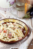 Eggplant, pancetta and parmesan pasta Royalty Free Stock Images
