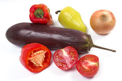 Eggplant, pepper, onions. And tomatoes on a white background Stock Photo