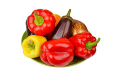 Eggplant and pepper on plate Stock Photos
