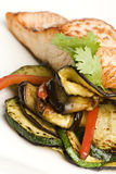 Eggplant and peppers with baked salmon Stock Photos