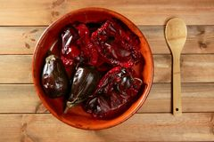 Eggplant and peppers roasted on clay vessel Royalty Free Stock Photography