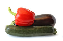 Eggplant, peppers and zucchini on white backgrou Stock Photos