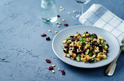 Eggplant pine nuts parsley dried cranberries salad Stock Photography