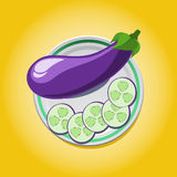 Eggplant on a plate with slices Royalty Free Stock Photography