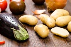 Eggplant and potatoes Stock Photo