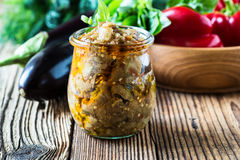 Eggplant preserve in glass jar Stock Images