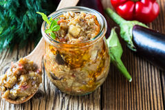 Eggplant preserve in glass jar. On a rural table Royalty Free Stock Images
