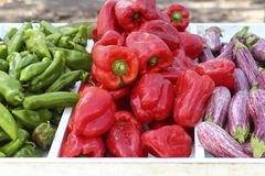 Eggplant red pepper green peppers on market store Stock Photography