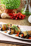 Eggplant rolls with cheese, tomato and basil Stock Images