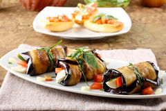 Eggplant rolls with cheese, tomato and basil Royalty Free Stock Photos