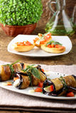 Eggplant rolls with cheese, tomato and basil Stock Image