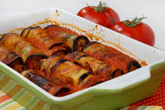 Eggplant rolls filled with meat. And vegetable in tomato sauce Stock Images