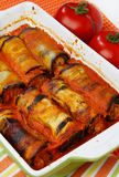 Eggplant rolls filled with meat. And vegetable in tomato sauce Royalty Free Stock Photos