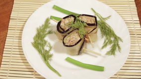 Eggplant rolls with filling of forcemeat. The finished dish of eastern cuisine stock footage