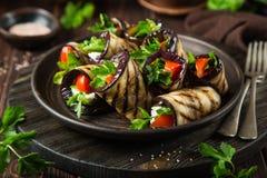 Eggplant rolls with garlic feta, tomato and herbs Royalty Free Stock Photos