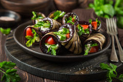 Eggplant rolls with garlic feta, tomatoes and herbs stock photos