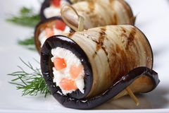 Eggplant rolls stuffed with cottage cheese and tomatoes Royalty Free Stock Photos