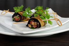 Eggplant rolls stuffed with vegetables Stock Photos