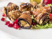 Eggplant rolls with walnuts. Delicious fried aubergines with nuts, herbs and pomegranate seeds. Dish of Georgian cuisine.  stock photography
