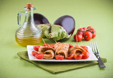 Eggplant roulades with cherry tomato salad. Stock Photography