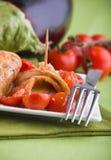 Eggplant roulades with cherry tomato salad. Stock Photos