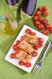 Eggplant roulades with cherry tomato salad. Royalty Free Stock Photo