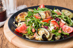 Eggplant salad with tomatoes and arugula Royalty Free Stock Image
