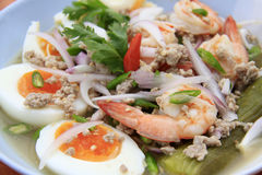 Eggplant salad whit eggs and shrimps, Thai-food. This salad was composed of grilled slices of Thai eggplant topped with the classic chili, lime, and fish sauce royalty free stock photography