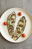 Eggplant slices and cherry tomatoes on the plate Stock Images