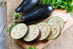 Eggplant slices cut on a board Stock Images