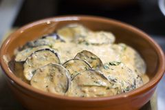 Eggplant stewed in sour cream sauce stock photos